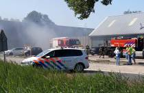Autobrand in parkeergarage Poiesz Supermarkt Oudehaske